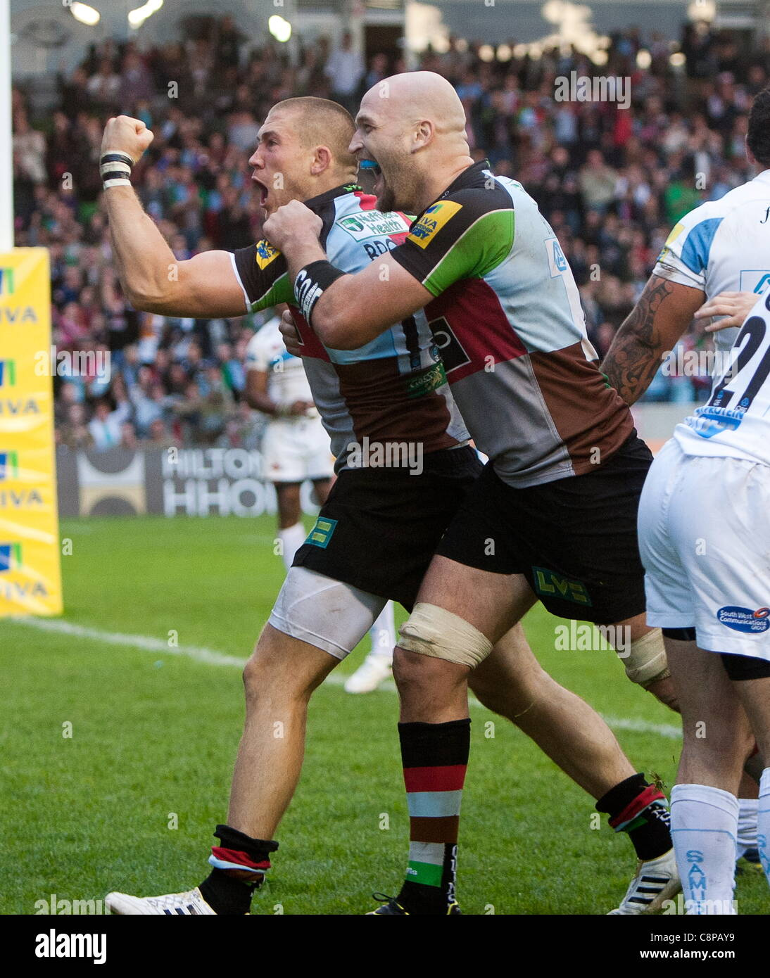 Mike Brown celebrates his winning try with George Robson who is playing in his 100th game for Harlequins. They beat - Stock Image