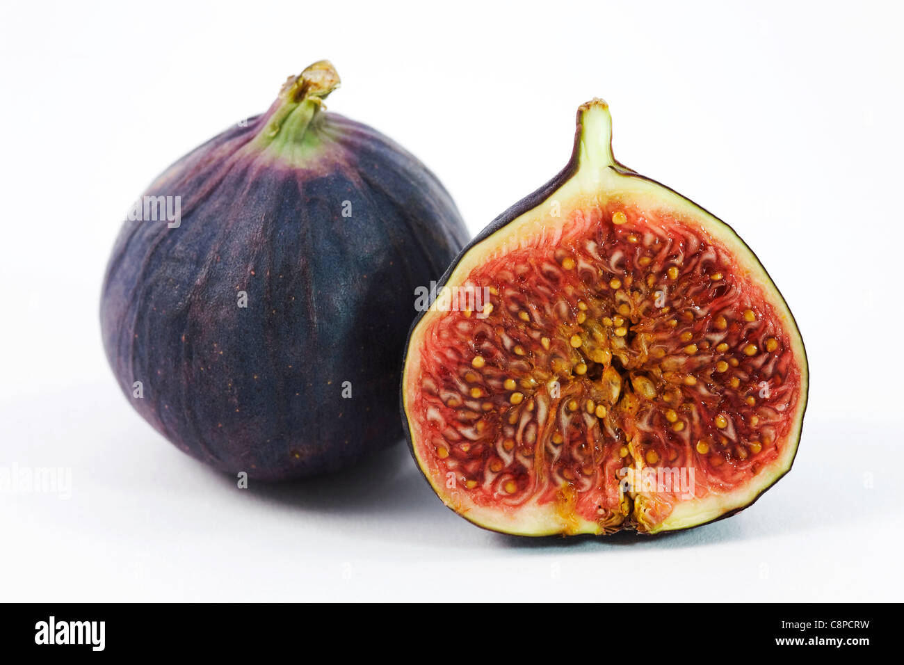 Ficus carica. Black Bursa fig cross section on a white background. - Stock Image