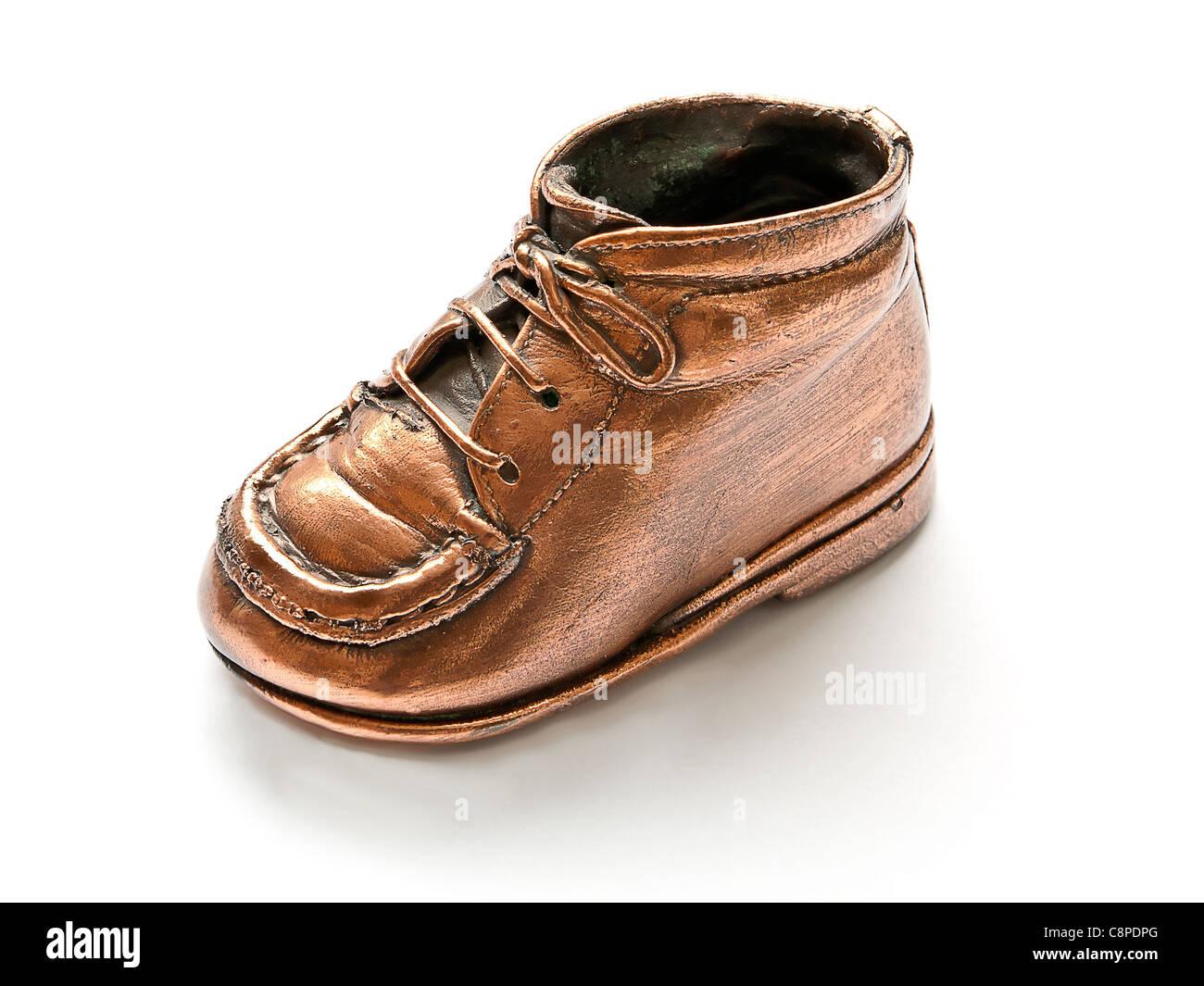 Metallic Shoe Stock Photos Images Alamy D Island Shoes Style Hikers Dm Mens Leather Cokelat Single Bronze Baby On White Background Image