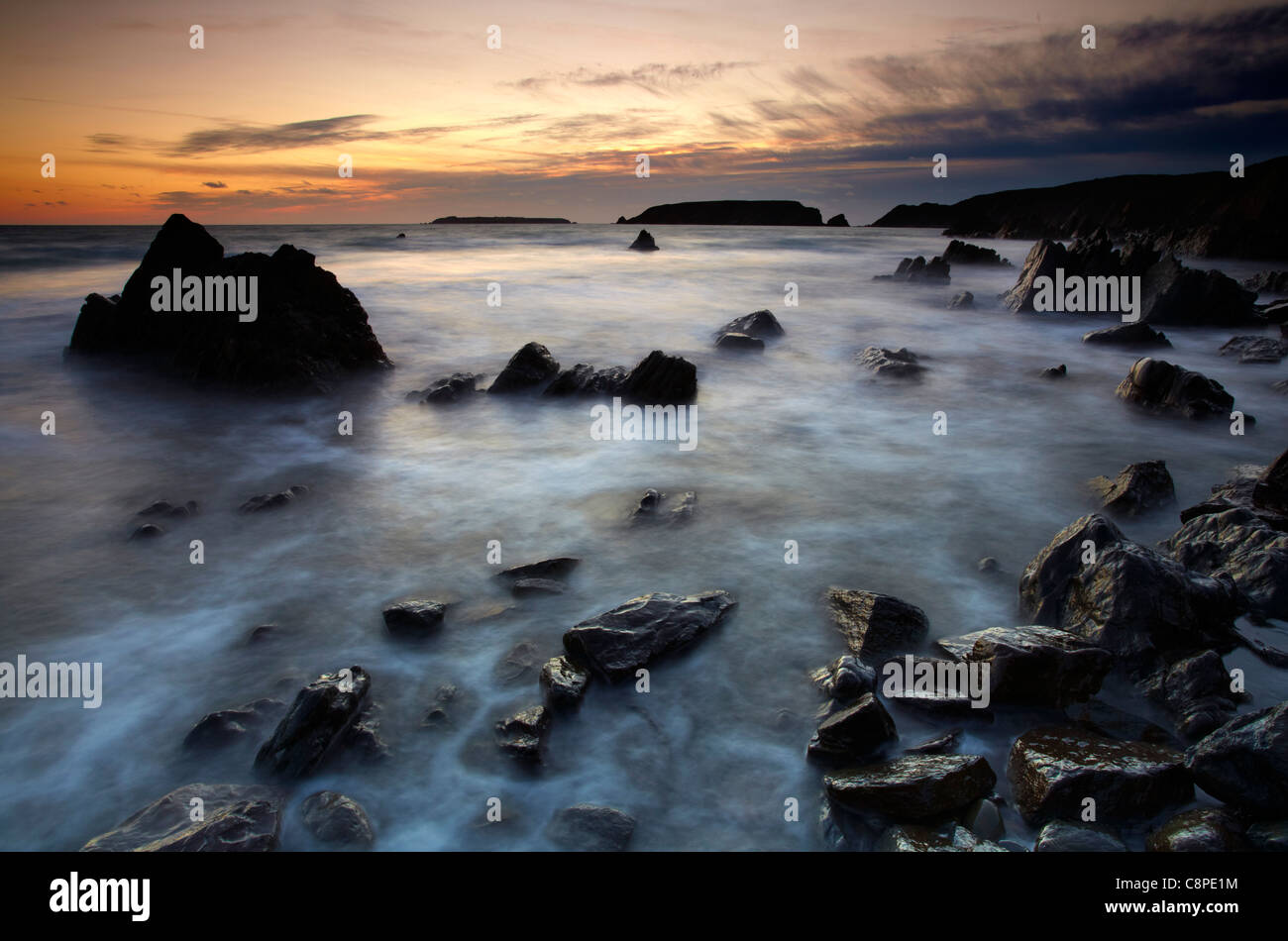 Dusk at Marloes, looking towards Gateholm and Skokholm Islands, Pembrokeshire, West Wales. - Stock Image