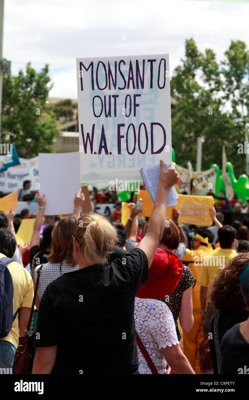 Protester holding Monsanto Out of WA Food placard at Occupy Perth protest which coincided at CHOGM 2011. - Stock Image
