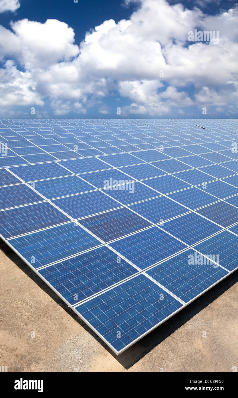 Solar Panels with cloud sky background - Stock Image