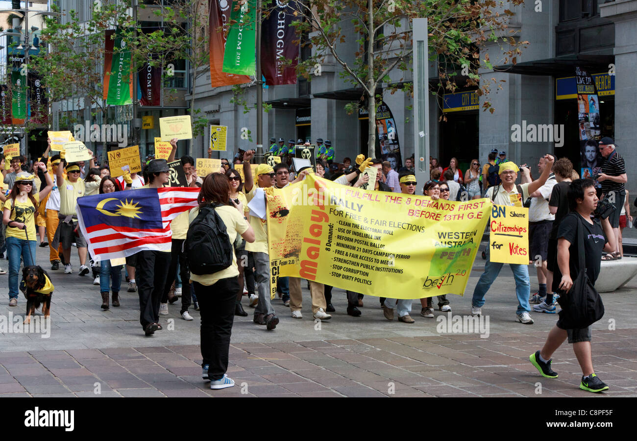 Malaysian protesters with banner demanding electoral reform at Occupy Perth /  CHOGM 2011 protests. Stock Photo