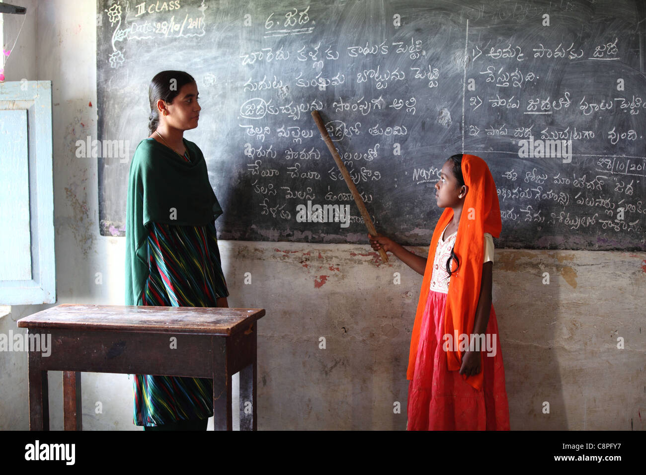 Muslim Indian girl with teacher at school Andhra Pradesh South India - Stock Image