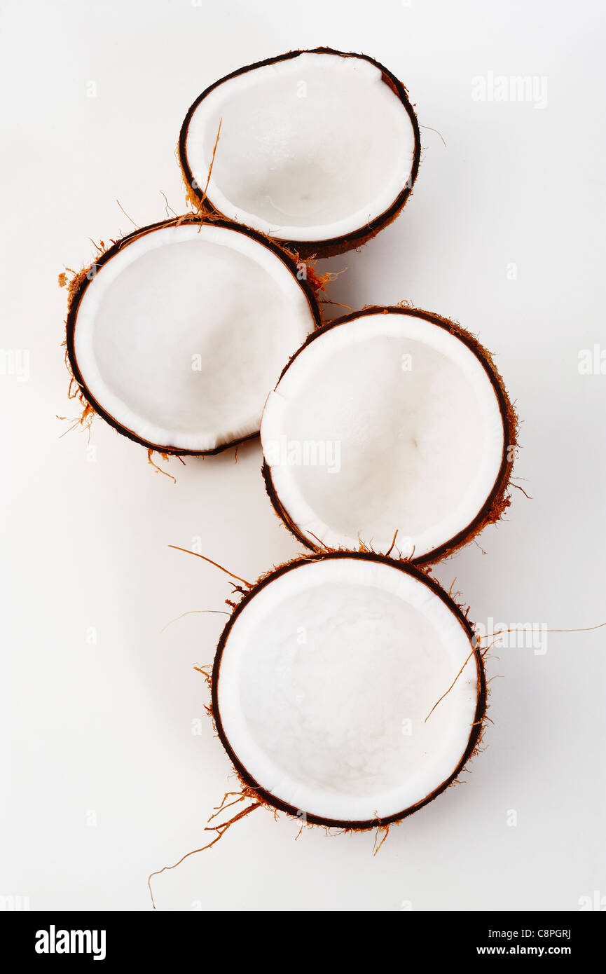 open coconut on white background - Stock Image