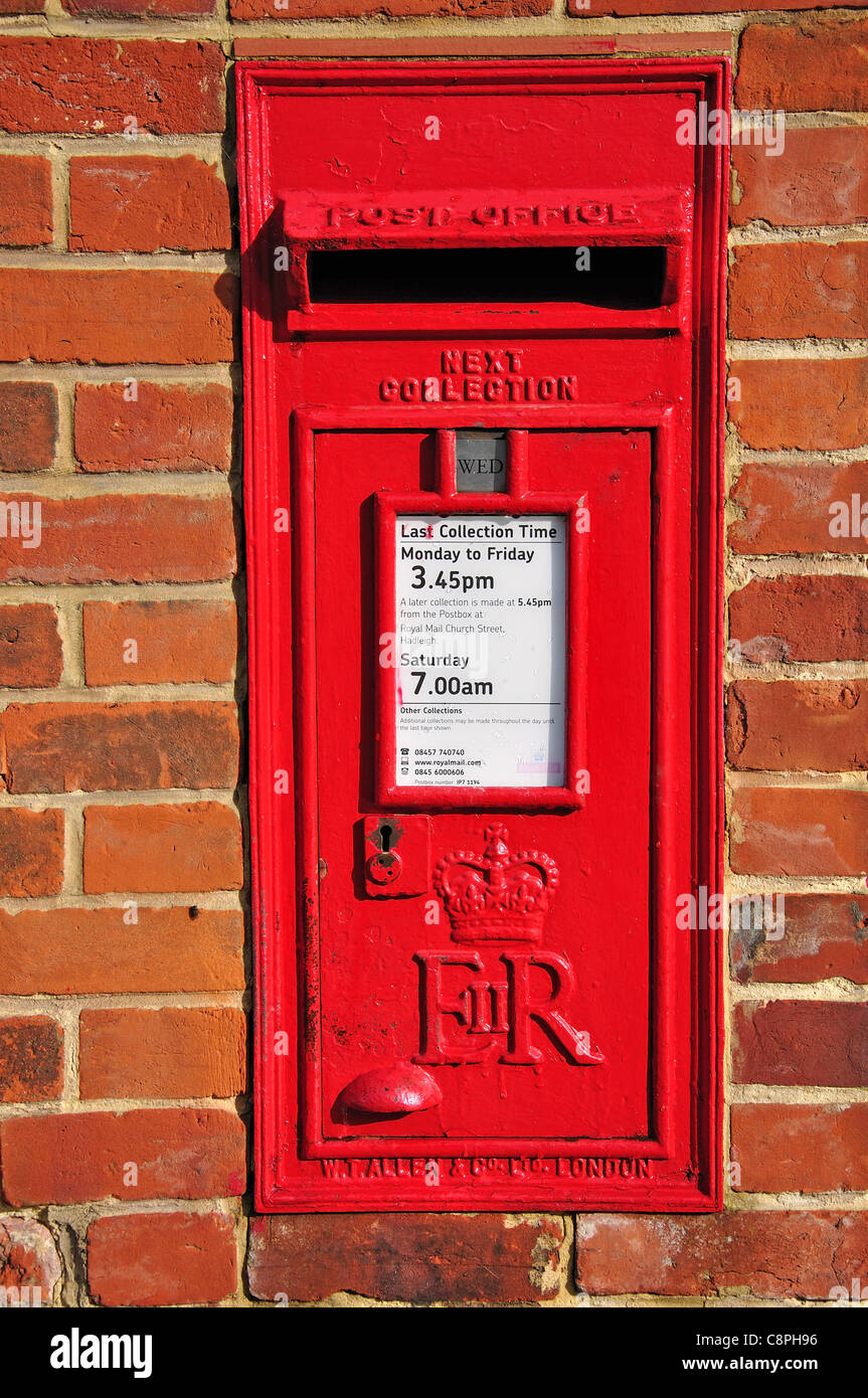Period post box on wall, The Street, Kersey, Suffolk, England, United Kingdom - Stock Image