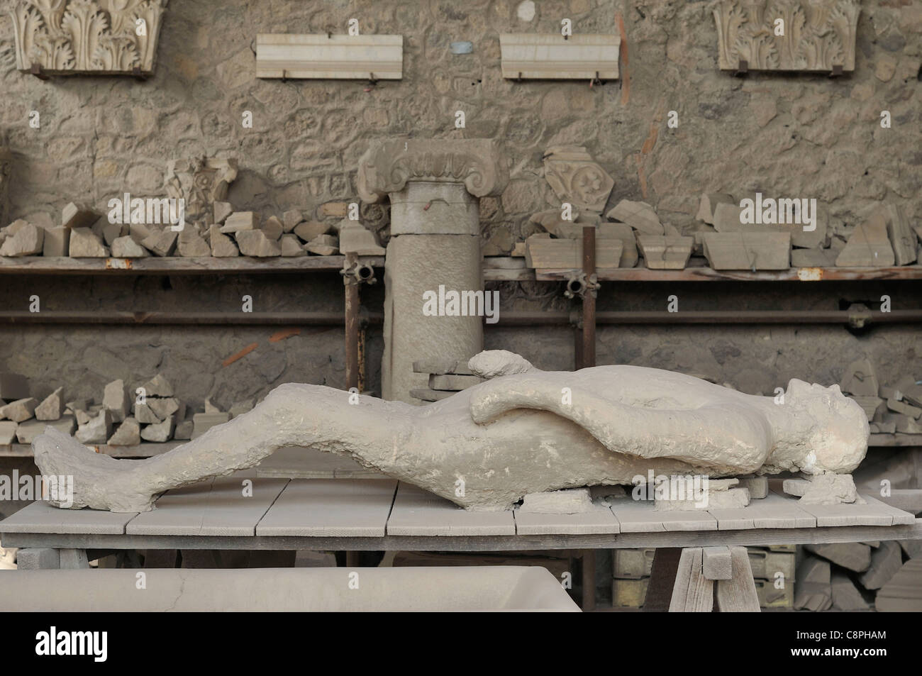 Pompei. Italy. Plaster cast of victim of the eruption of Vesuvius. - Stock Image