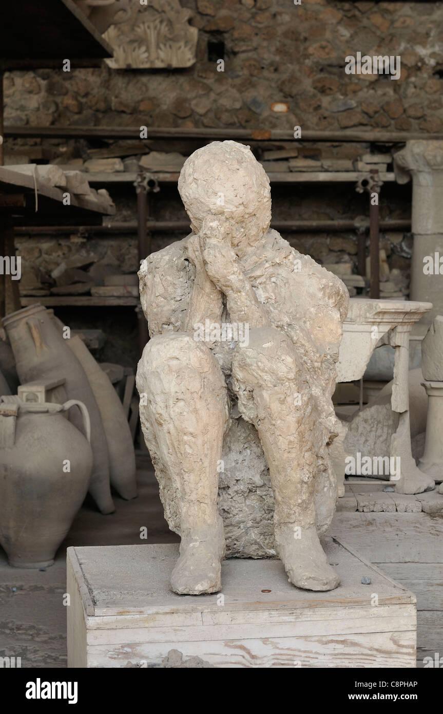 Pompei. Italy. Plaster cast of victim of the eruption of Vesuvius, Pompeii archaeological site. - Stock Image