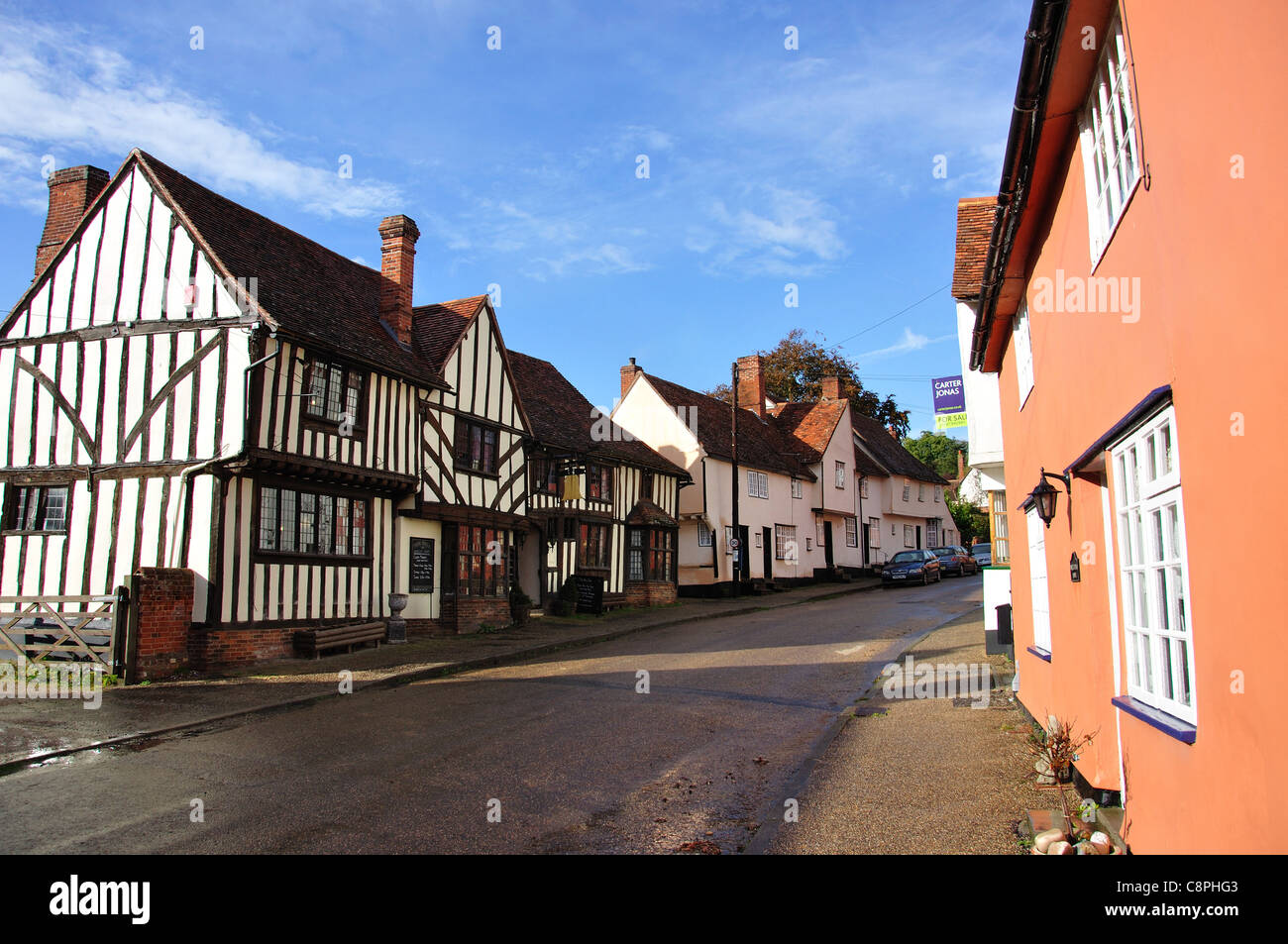 The Bell Inn and houses on The Street, Kersey, Suffolk, England, United Kingdom - Stock Image