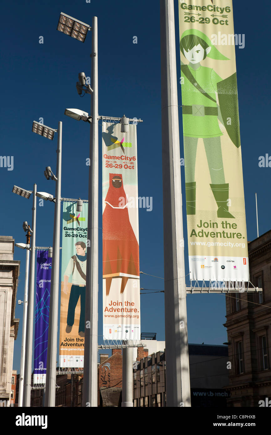 UK, Nottinghamshire, Nottingham, Old Market Square, colourful banners advertising Game City event Stock Photo