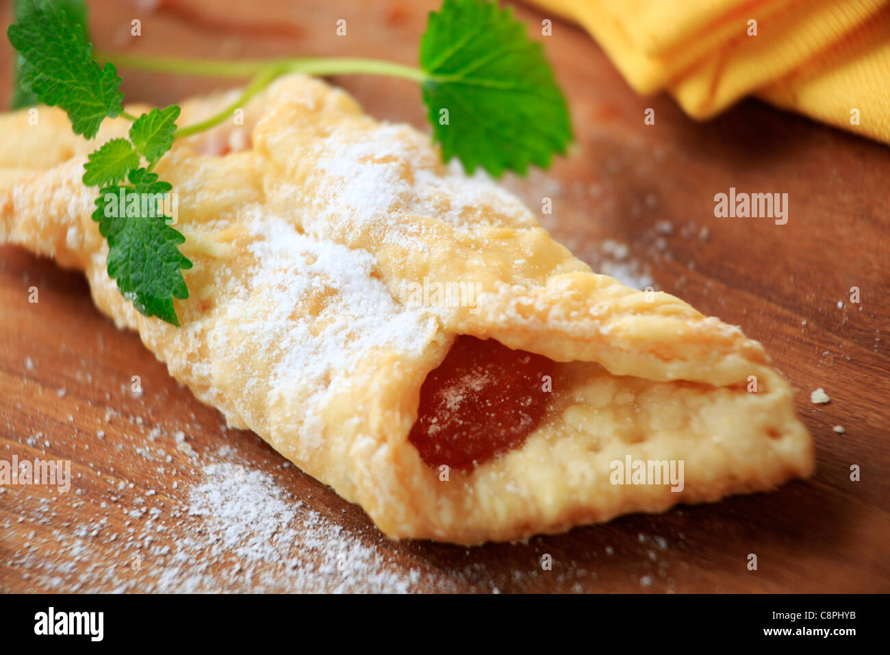 Sweet pastry turnover filled with jam - closeup - Stock Image