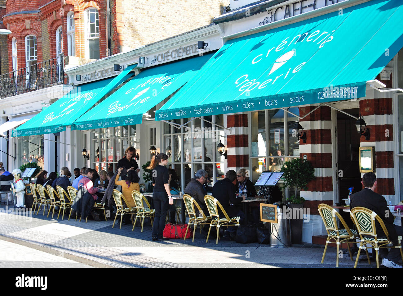 Outdoor cafe, Exhibition Road, Kensington, Royal Borough of Kensington and Chelsea, London, Greater London, England, - Stock Image