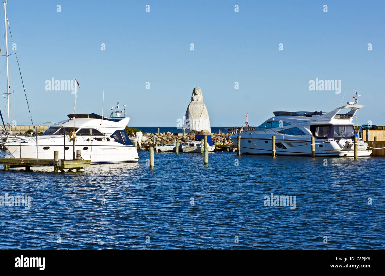 The statue depicting Fruen fra Havet (The lady from the Sea) in Saeby Harbour Jutland Denmark - Stock Image