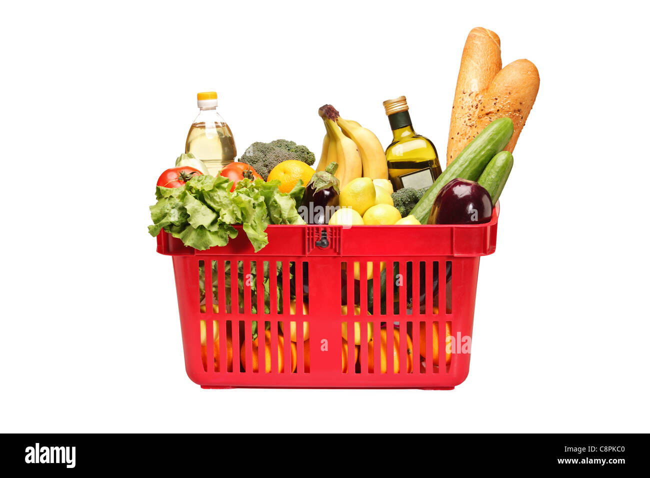 A studio shot of a shopping basket full of groceries - Stock Image