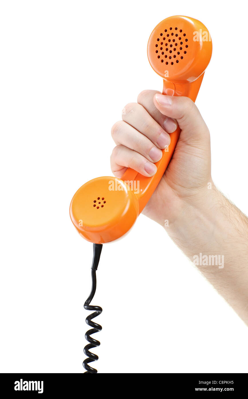 Hand holding an old orange telephone tube Stock Photo