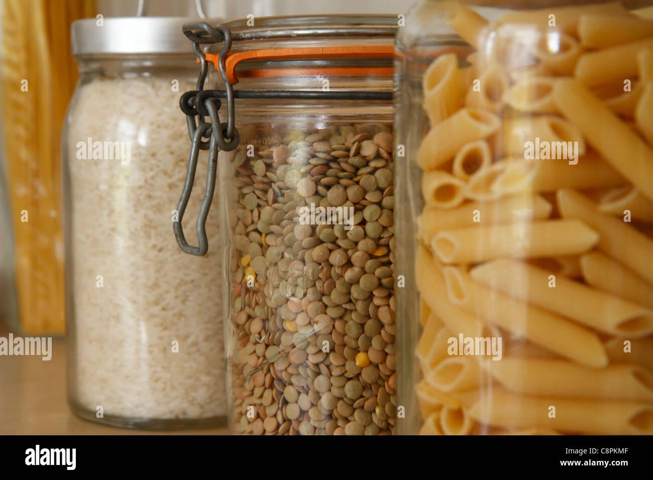 Glass kitchen storage jars - Stock Image