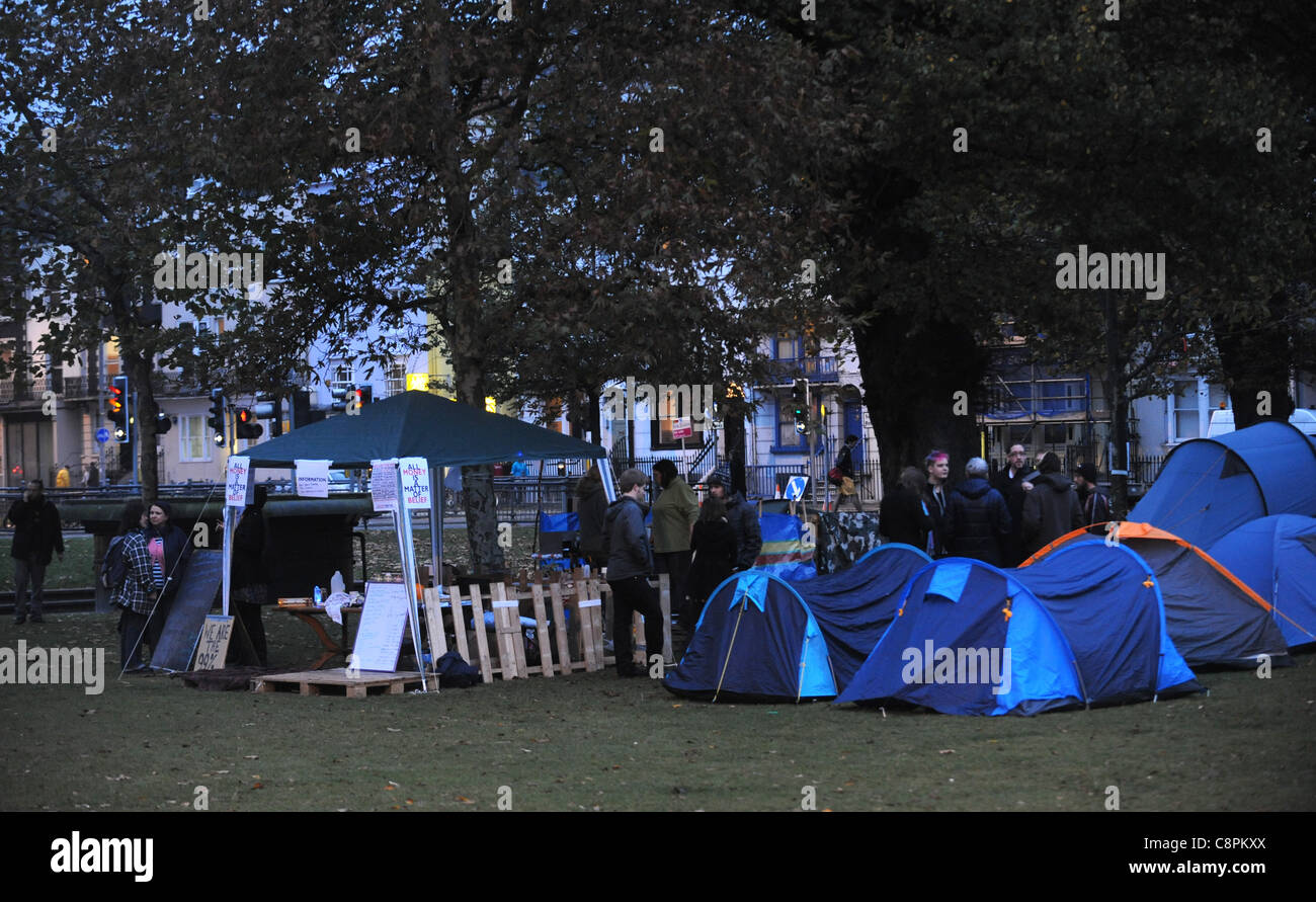 The latest anti capitalist tented protest Occupy Brighton in Victoria Gardens in the city centre UK at dusk - Stock Image