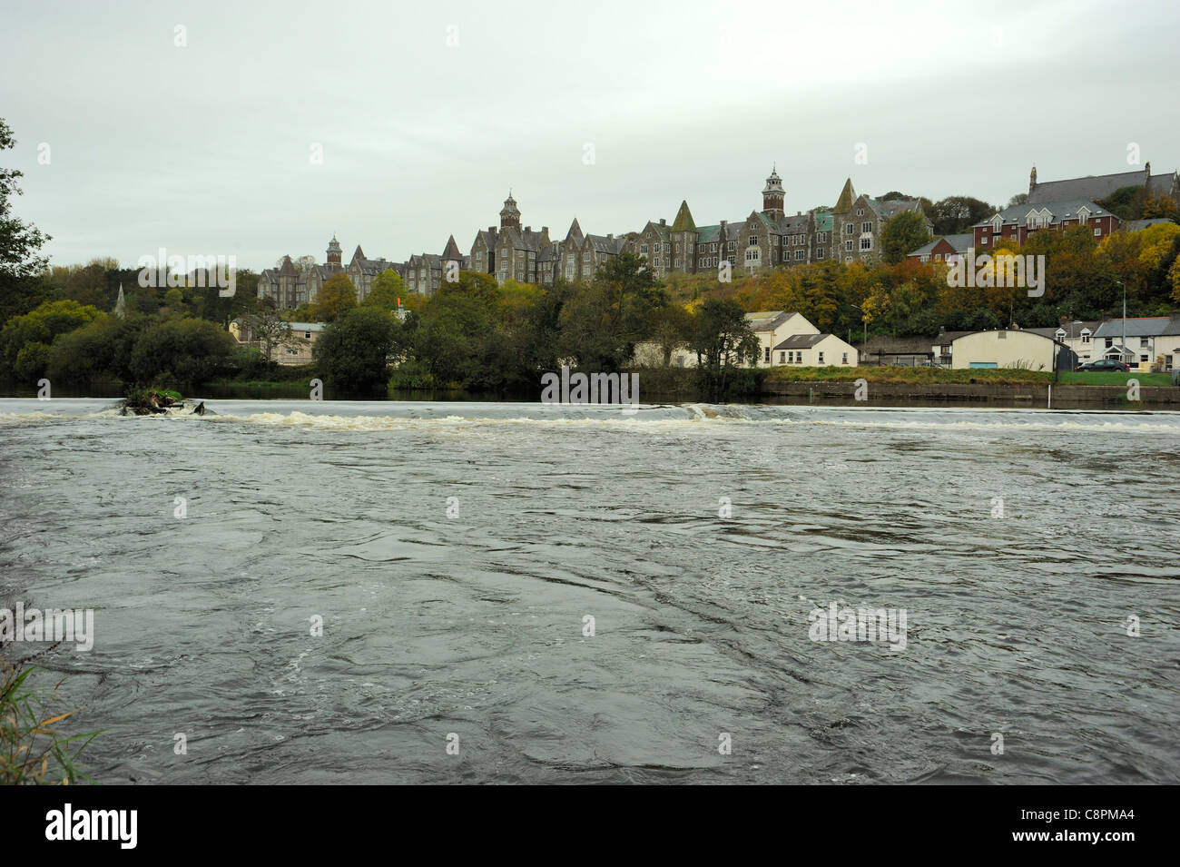Atkins Hall and River Lee weir, Cork City, (was Our Lady's Psychiatric Hospital Cork) - Stock Image
