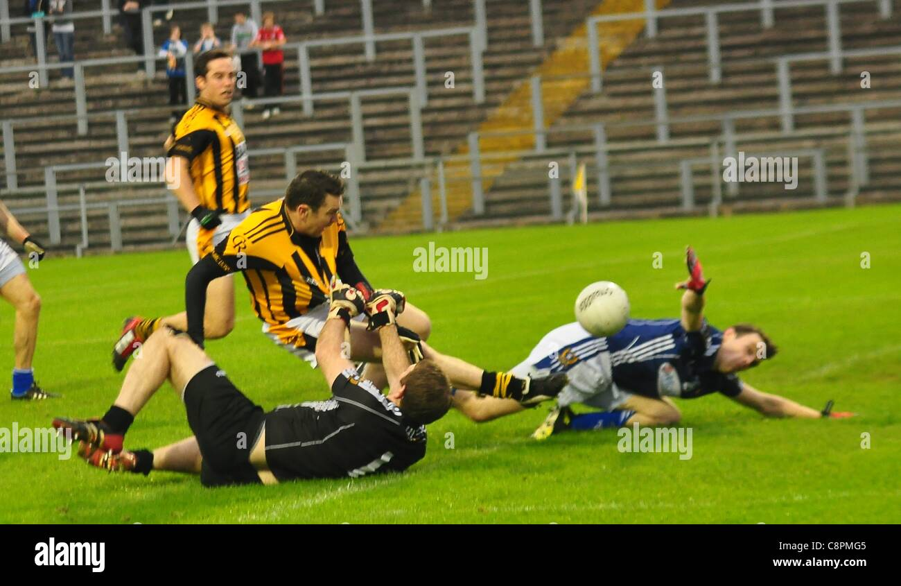 Saint Gall's Ronan Gallagher pulls down Crossmaglen's Oisin McConville give away a penalty. Reigning Ulster and Stock Photo