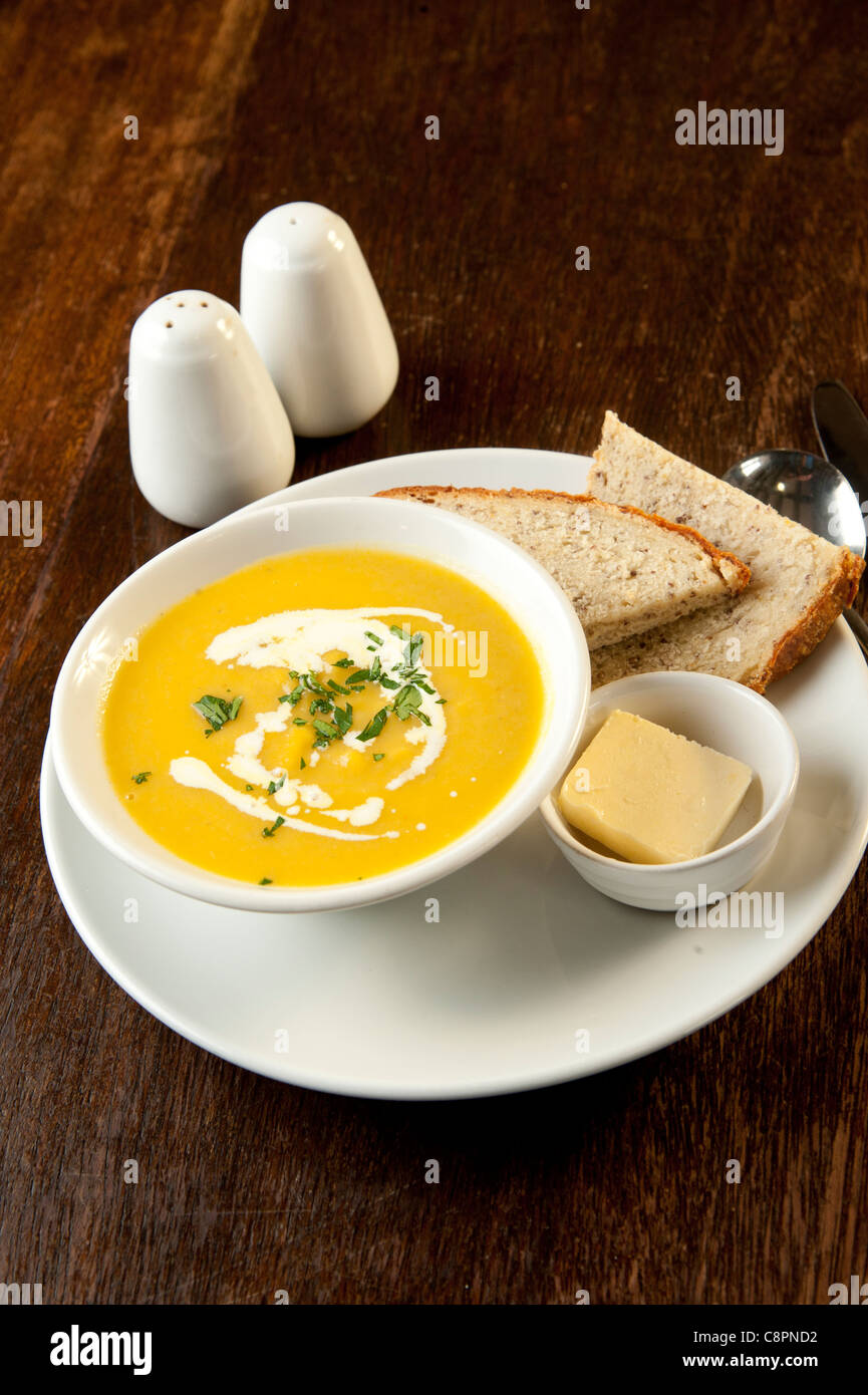 Spicy butternut and pumpkin soup with coconut milk at Y Ffarmers pub restaurant, Llanfihangel y Creuddyn, Ceredigion, - Stock Image