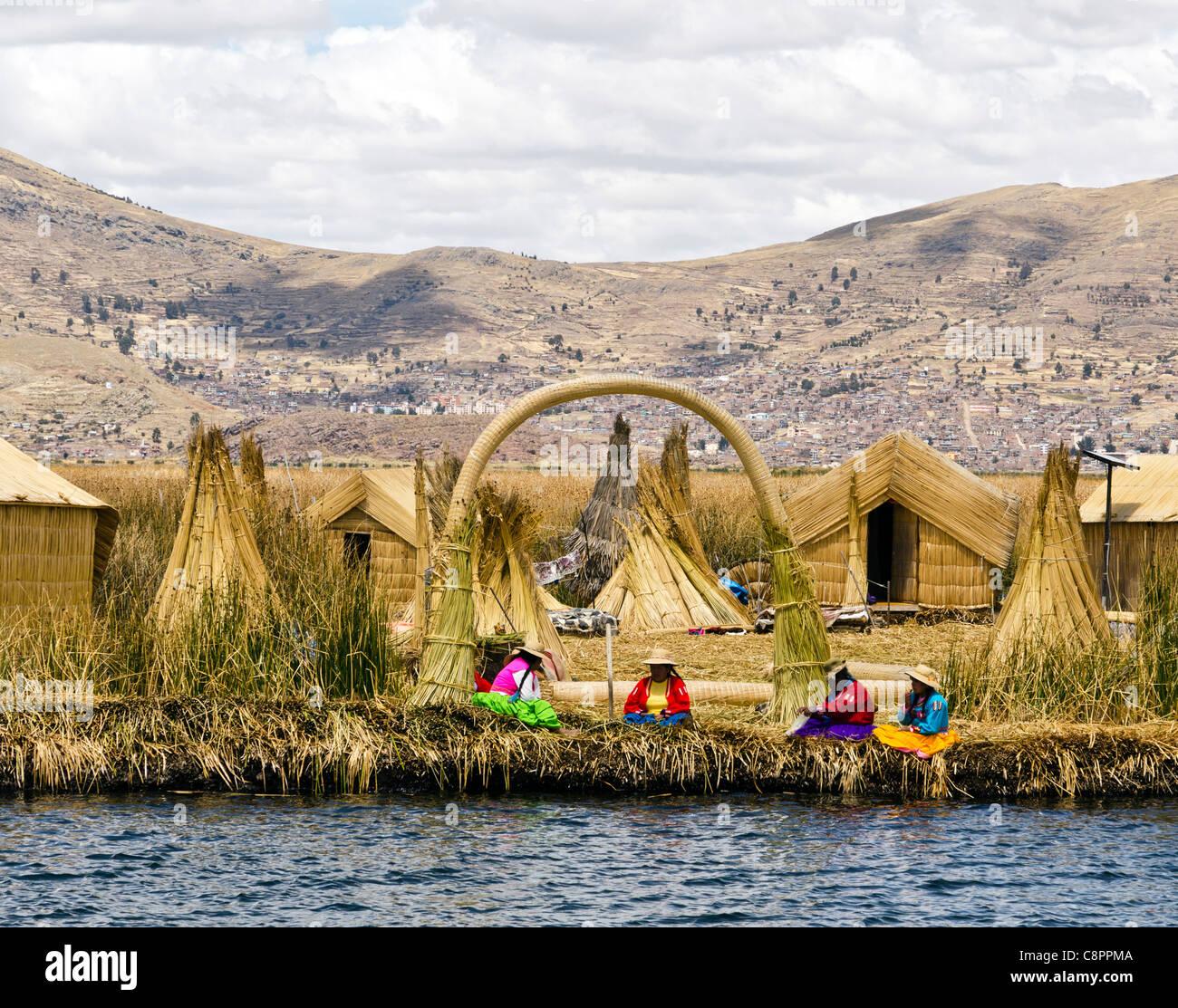 Women wearing traditional peruvian costume Uros island Titicaca lake Puno Peru - Stock Image