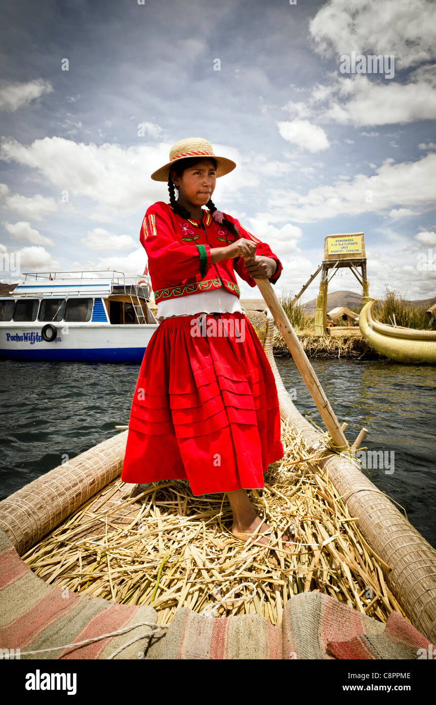 Young girl wearing traditional costume from Uros Islands Titicaca Lake Puno region Peru - Stock Image