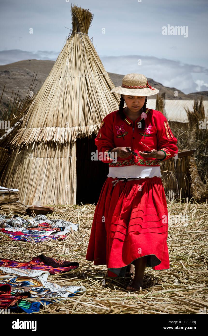 Woman wearing a traditional costume Uros islands Titicaca lake Puno region Peru - Stock Image