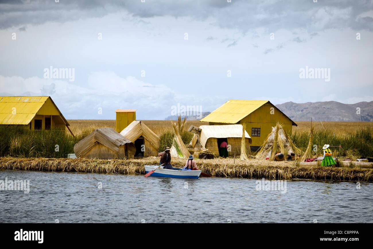 People on Uros island floating islands Puno Peru - Stock Image