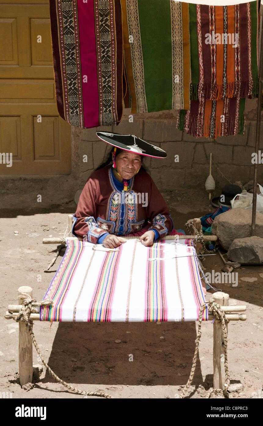 Peruvian woman weaving tapestry street market Puno Peru - Stock Image