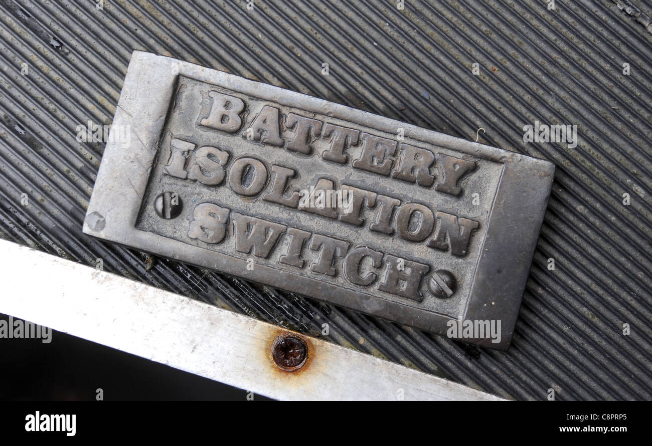 BATTERY ISOLATION SWITCH SIGN ON CANAL NARROWBOAT BARGE RE POWER MAINTENANCE DANGER ELECTRICAL ELECTRICITY ETC UK - Stock Image