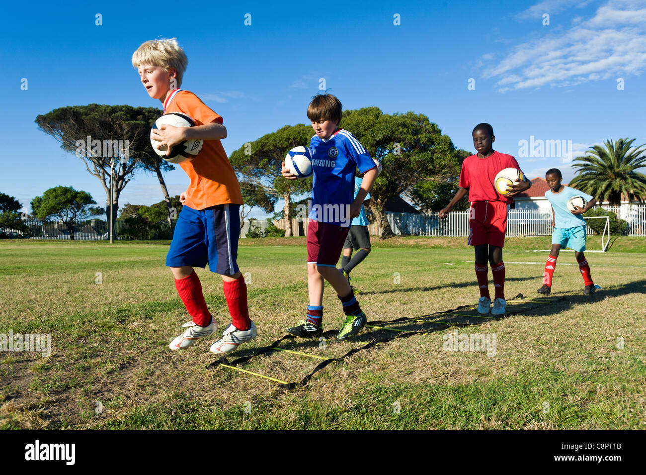 Junior football players practicing ball skills Cape Town South Africa - Stock Image