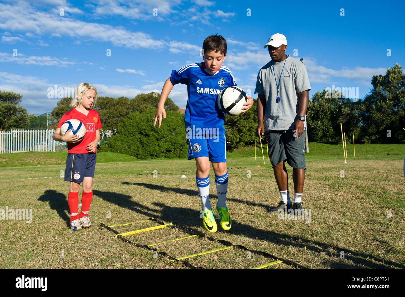 Junior football players practicing skills Cape Town South Africa - Stock Image