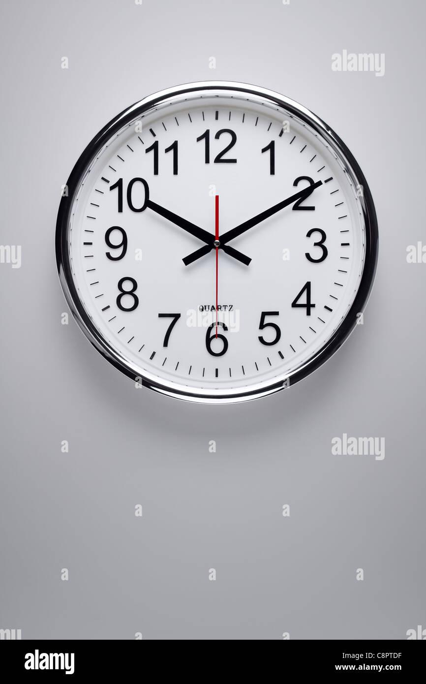 Clock at the wall - Stock Image