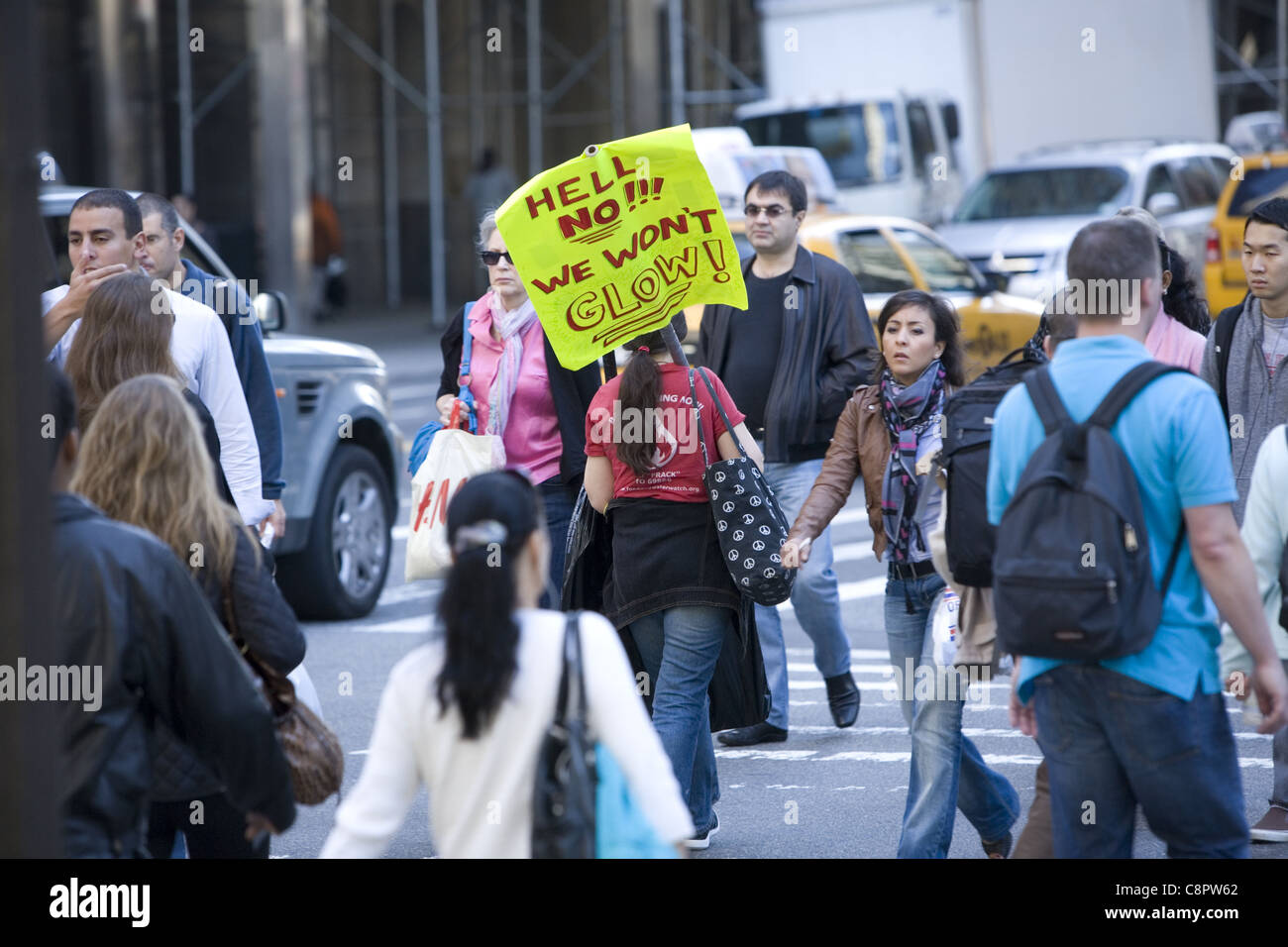 Woman activist,  walking on 42nd St. to A 'Shut Down Indian Point Nuclear Power Plant' rally in NYC. - Stock Image