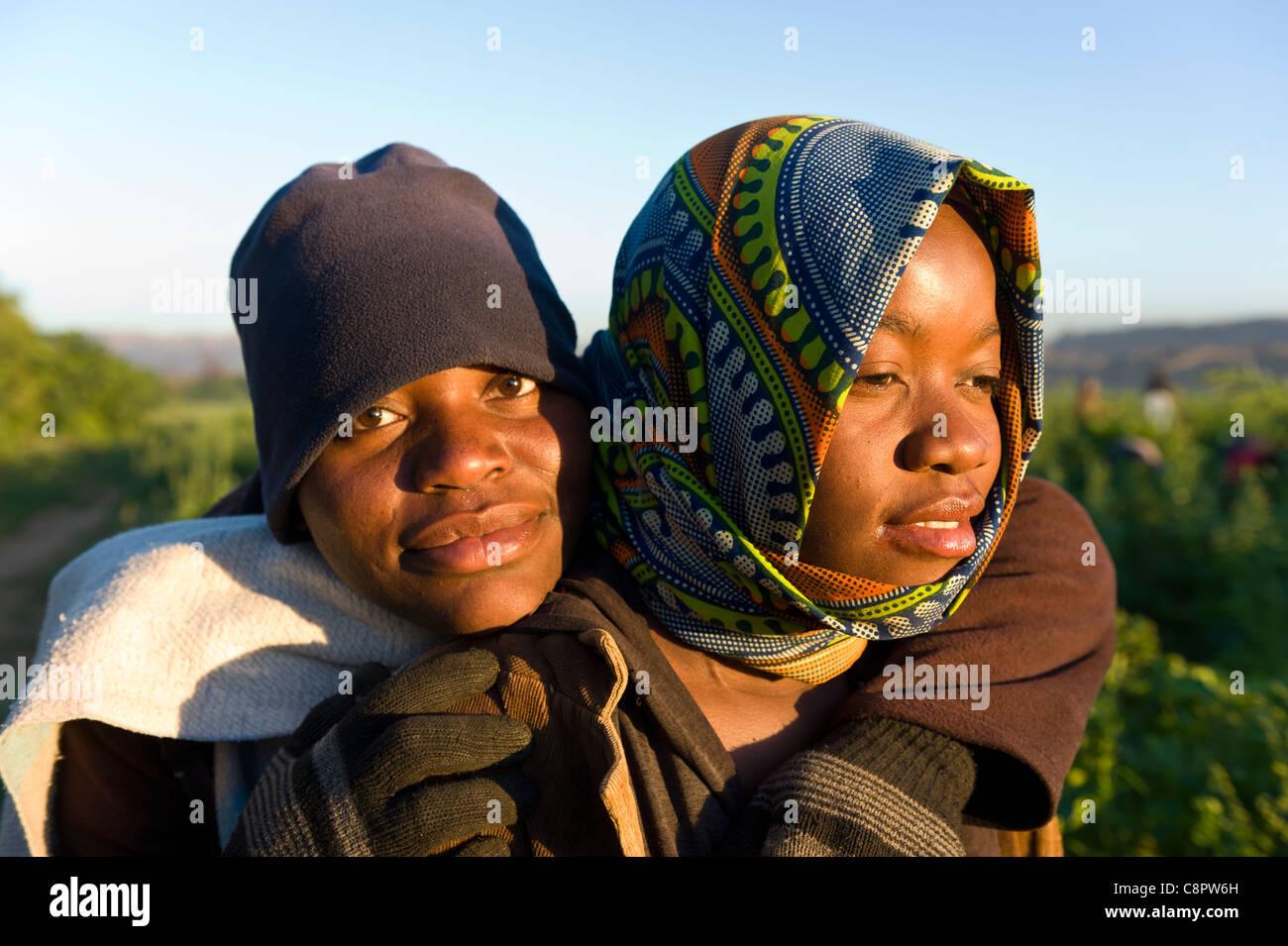 Field workers hugging Noordoewer Namibia - Stock Image