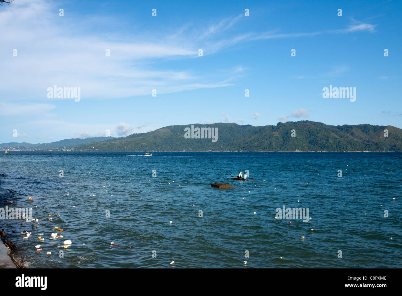 Plastic bottles and litter floating in the sea. Ambon, Indonesia - Stock Image