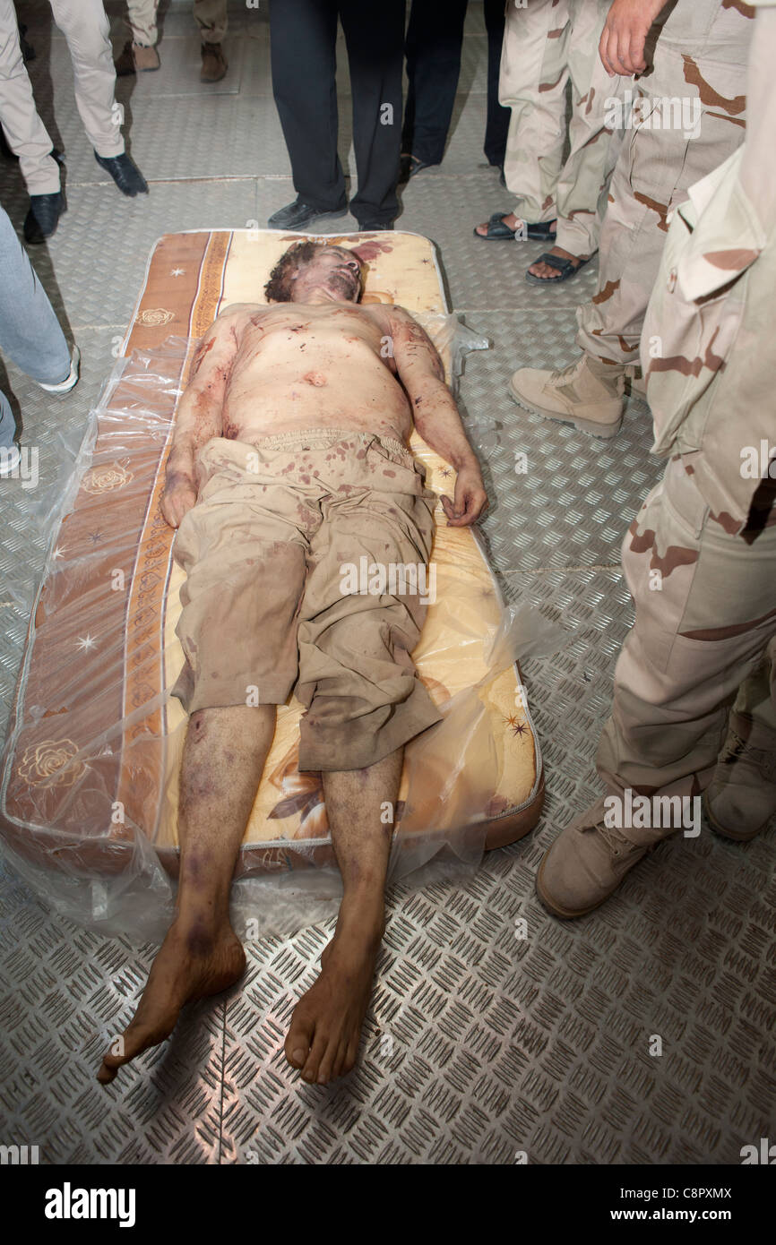 The body of col Gaddafi in the meat freezer at the African market in Misrata - Stock Image