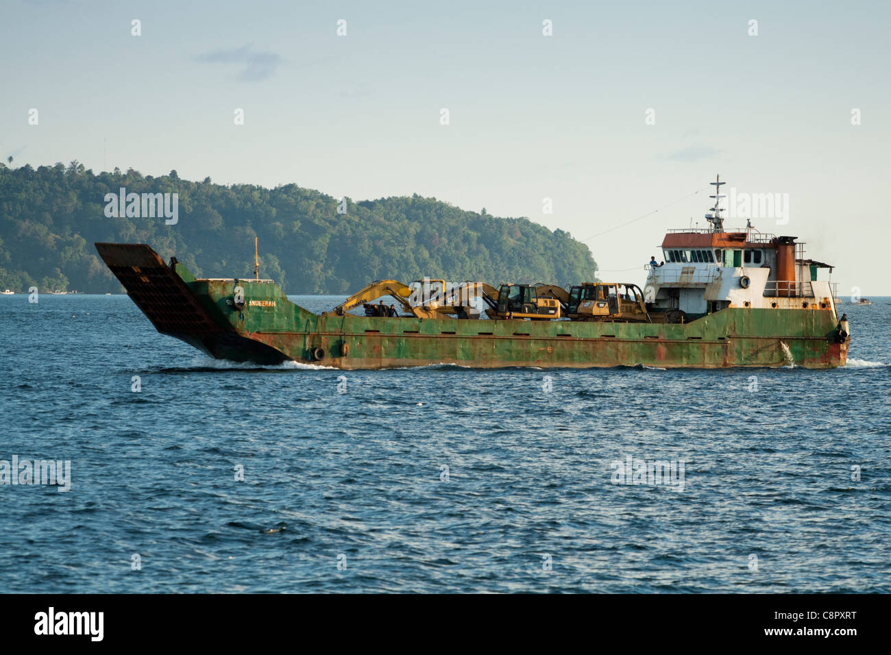 Transporter or cargo ship carrying bulldozers, Ambon, Indonesia, Asia - Stock Image