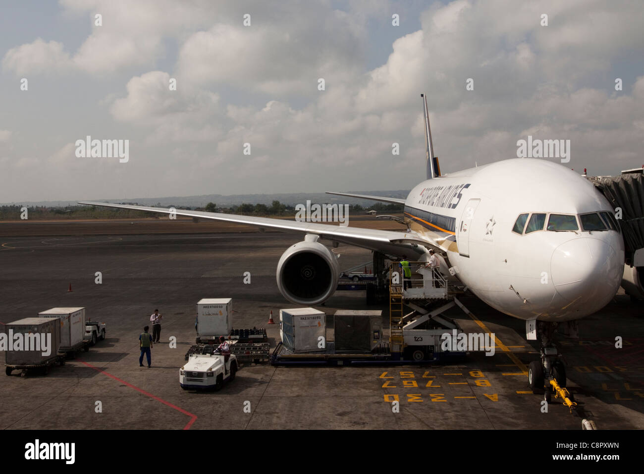 Singapore Airlines aircraft/plane being loaded with cargo, Indonesia, Asia - Stock Image