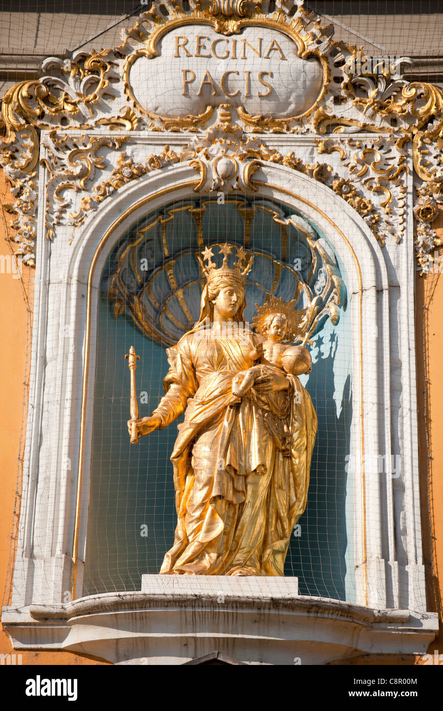 golden Statue of Regina Pacis- Maria with child at the facade of Kurfuerstliches Schloss in Bonn, Germany Stock Photo