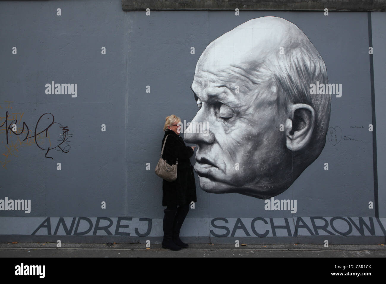 Andrei Sakharov pictured by Russian artist Dmitri Vrubel on the Berlin Wall in East Side Gallery in Berlin, Germany. - Stock Image