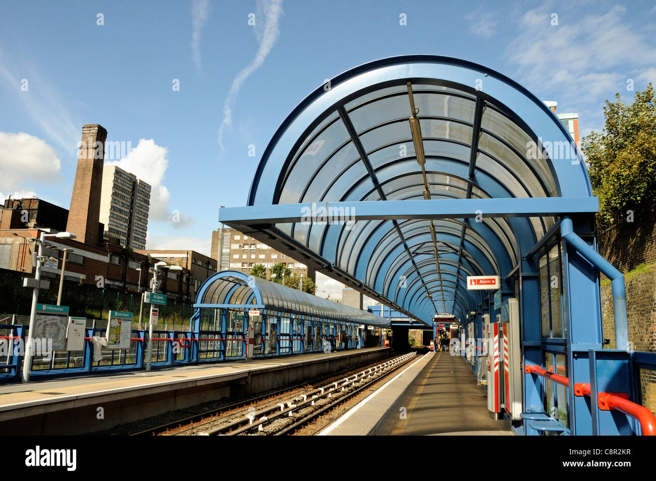 Platform with canopy All Saints Docklands Light Railway DLR Station Poplar Tower Hamlets East London England UK - Stock Image