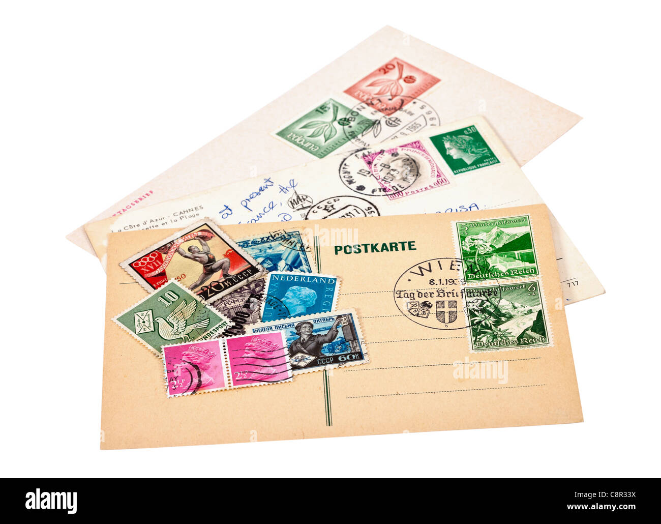 Postage stamps and postcards on white background - Stock Image