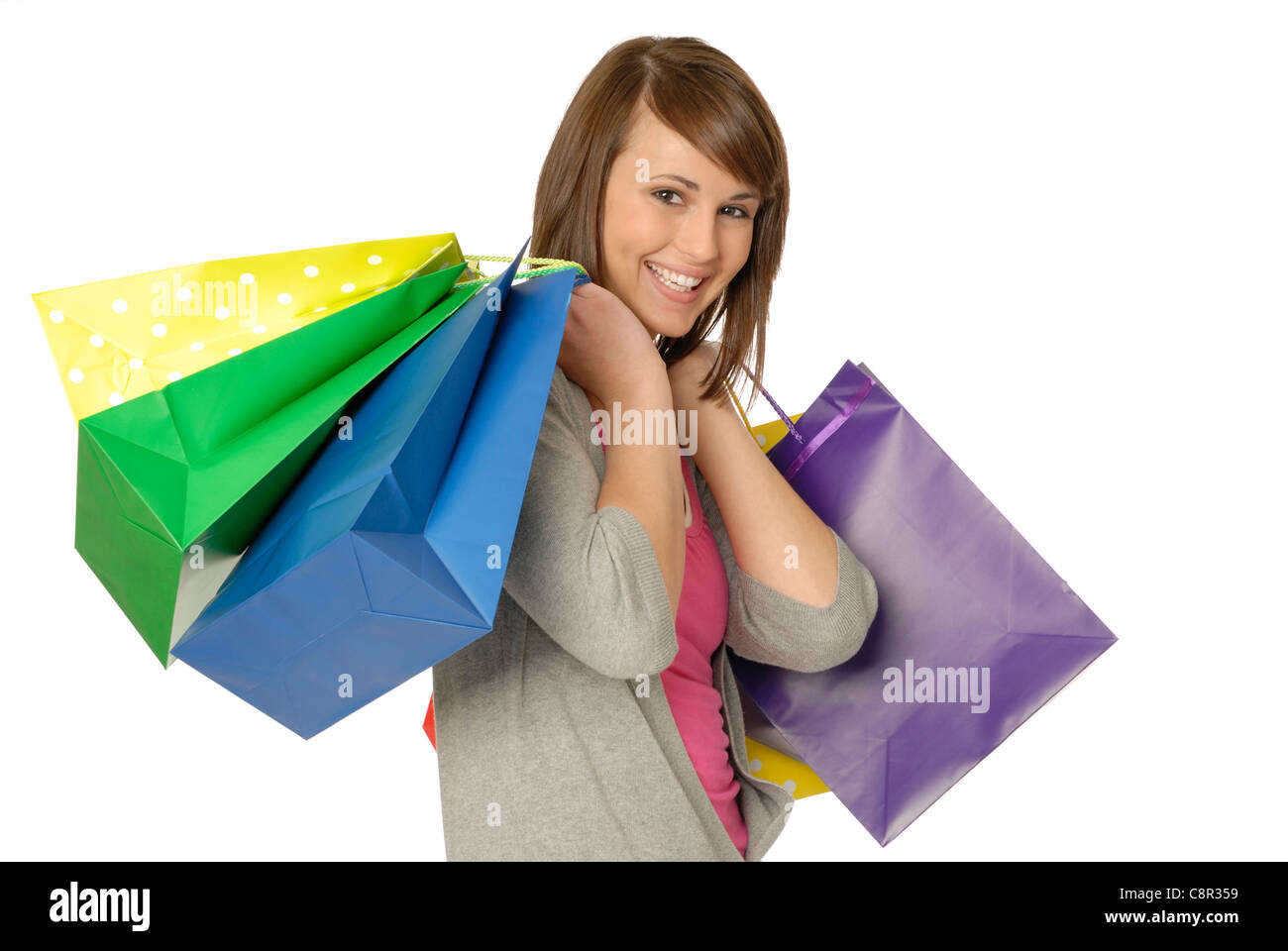 Beautiful, Fresh Faced, Young Woman, Smiling With Many Colorful Shopping Bags - Stock Image