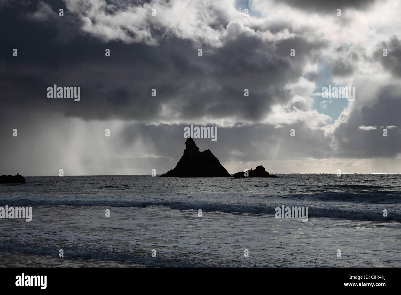 Storm Clouds Passing Behind Church Rock Broad Haven Beach Pembroke Pembrokeshire National Park Wales Cymru UK GB - Stock Image