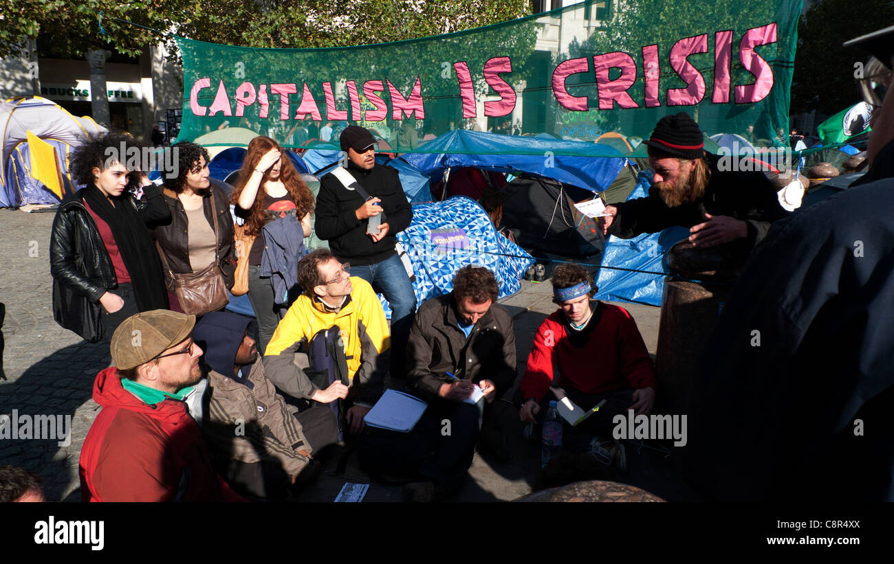 A group of protestors with Capitalism sign at Occupy London Stock Market demonstration 19/10/2011 outside St Paul's - Stock Image