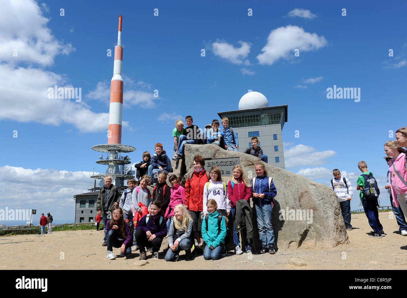 School children psoing for a photo at The summit of the Brocken mountain in the Harz Germany - Stock Image