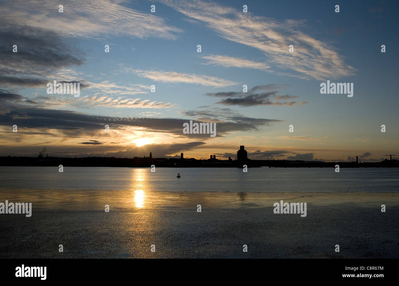 Liverpool UK Sunset looking over mersey river - Stock Image