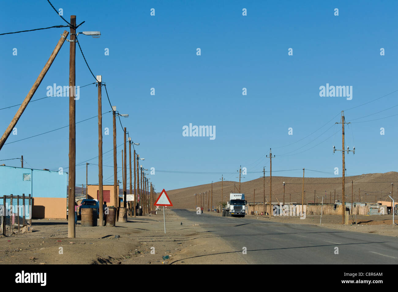 Powerlines along a road in Noordoewer Namibia - Stock Image