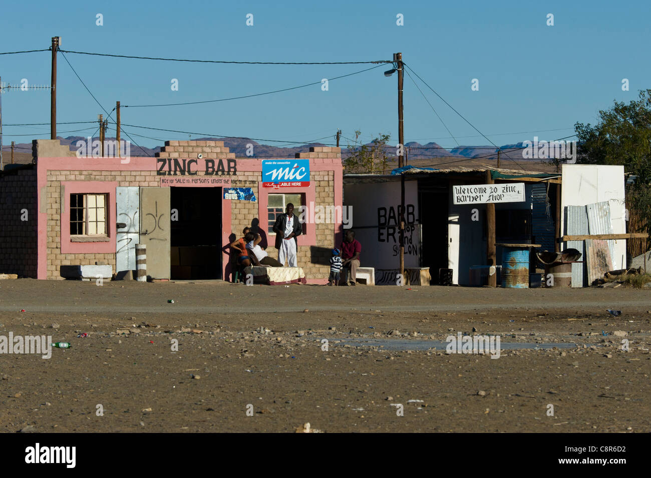 People sitting outside a bar in Noordoewer Namibia - Stock Image